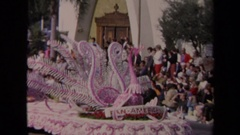 1967: crowds standing on the sideline watching a dove and princess float pass by Stock Footage