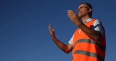Airport Worker Man Standing Marshall Directing Show Position a Aircraft Arrival Stock Footage