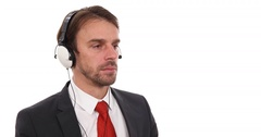 Attractive Businessman Listen Music with Headphones a Techno Style Office Studio Stock Footage