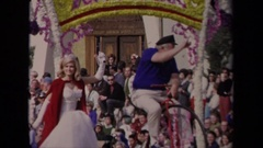 1967: sunny day and a parade float carrying the skipper from gilligan's island Stock Footage