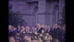 1967: ronald reagan inauguration men in suits appear at podium between audience Stock Footage