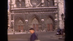 1939: people walking and driving through the traditionally built modern city Stock Footage