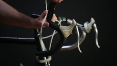 Wrapping handlebar tape on a road bike Stock Footage