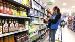 Grocery clerk changing price tag inside Walmart store Stock Footage