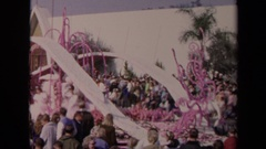 1967: parade float with a saint atop one and another float with three women Stock Footage