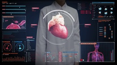 Female doctor touching digital screen, heart. Human cardiovascular system. Stock Footage