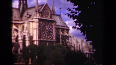 1939: towers rise high above a stately old gothic church PARIS FRANCE Stock Footage