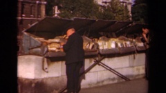 1939: a group of people stand around looking in dumpsters PARIS FRANCE Stock Footage