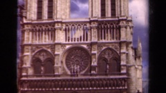 1939: the catholic cathedral notre dame on a partly cloudy day PARIS FRANCE Stock Footage