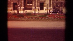 1939: black car driving down city street with view of flowers PARIS FRANCE Stock Footage