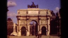 1939: people walk around in a plaza near an arch in a city PARIS FRANCE Stock Footage