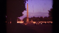 1939: there are many number of people travelling with their vehicles on the city Stock Footage