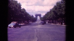 1939: vehicles on a road driving toward an entrance way PARIS FRANCE Stock Footage