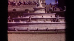 1939: a woman posing with a man wearing an army uniform in front of fountain Stock Footage