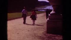 1939: pedestrians walk down a large dirt pathway toward a waterway  Stock Footage