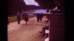 1939: a group of people are strolling on a path towards a pond PARIS FRANCE Stock Footage
