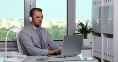 Young Handsome Business Man with Headphones Listening Happy Music Office Hours Stock Footage