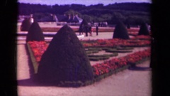 1939: people in the well designed garden PARIS FRANCE Stock Footage