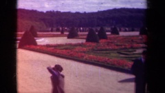 1939: a group of tourists stand around in a sprawling garden PARIS FRANCE Stock Footage
