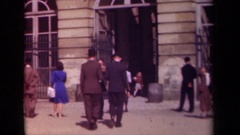 1939: people walking into a building nicely dressed PARIS FRANCE Stock Footage