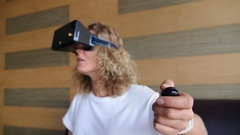 Female Playing in VR Goggles Stock Footage