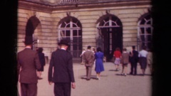 1939: many people walking into a building with unique architectural details. Stock Footage