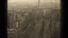 1947: cars drive down a city street on a winter's day PARIS FRANCE Stock Footage