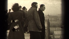 1947: a group of people visit a historic site on a windy day PARIS FRANCE Stock Footage