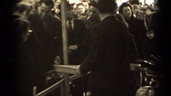 1947: two people selling steel plates where crowd is not buying anything. PARIS Stock Footage
