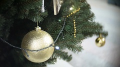 Big golden matte ball and lights. New Year's and abstract blurred shopping mall Stock Footage