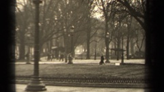 1947: people walk on a path on a winter day at a park in a city PARIS FRANCE Stock Footage