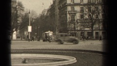 1947: group of buildings and many vehicles going down a road PARIS FRANCE Stock Footage