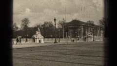 1947: people walk along a busy street near a large building PARIS FRANCE Stock Footage