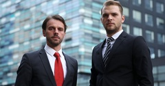 Serious Confident Businessmen Look Camera Front Corporation Headquarters Built Stock Footage