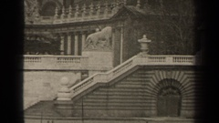 1947: a long arched bridge sits over a flowing river in a city PARIS FRANCE Stock Footage