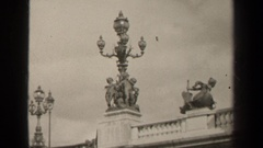 1947: detailed lamp posts on a bridge followed by a man dressed in black staring Stock Footage