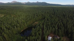 Aerial View of Rural Campground and Lake With Mountains in Background Stock Footage