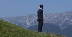 Confident Businessman Looking Around Standing Relaxed in a Beautiful Wilderness Stock Footage