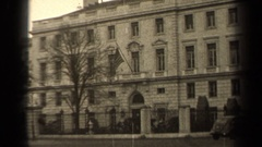 1947: people walking and a flag flying outside of a building PARIS FRANCE Stock Footage