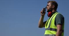 Airport Staff Call Using a Walkie Talkie Radio Giving Instructions Job Man Talk Stock Footage