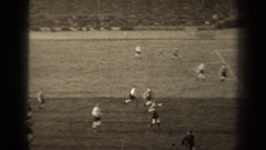 1947: playing football game in ground sincerely PARIS FRANCE Stock Footage
