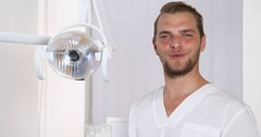 Attractive Dentist Man Talking Procedure Look Camera Smiling Cosmetic Dentistry Stock Footage