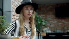 Elegant woman relaxing in the cafe and drink fancy beverage Stock Footage