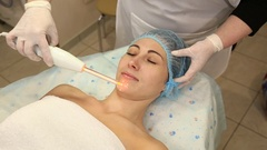 Cleaning of the face of a woman with the help of new technologies Stock Footage