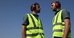 Airport Crew Men Collaboration Checking Team Airplane Vehicle Passing Overhead Stock Footage