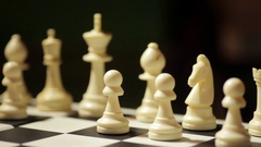 White pieces on a chess board Stock Footage