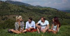 Happy Young People Group Sitting Drinking Juice Socializing Wilderness Mountains Stock Footage