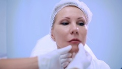 The woman planning the places of botox on the lips Stock Footage