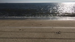 Hypnotic Waves In River Shore, Lisbon Downtown Stock Footage