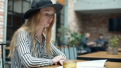 Elegant woman looks irritated while sitting in the cafe and waiting for order Stock Footage